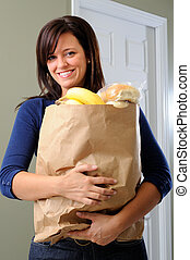Coming Home - Beautiful Woman Carrying Her Groceries Into...