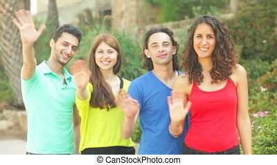 Chillax - Four friends waving hands to camera for a snapshot