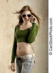 Fashion Model - Beautiful young fashion model over a grunge...