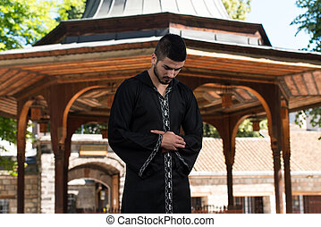 Humble Muslim In Dishdasha Prayer - Young Muslim Man Making...
