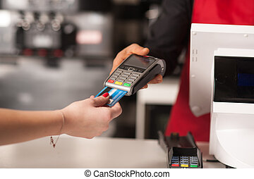 Debit card swiping on card-reader device - Staff receiving...