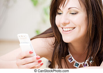 woman with white phone - portrait of happy woman with white...