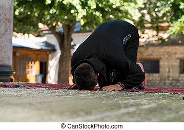 Young Muslim Man Praying - Young Muslim Man Making...