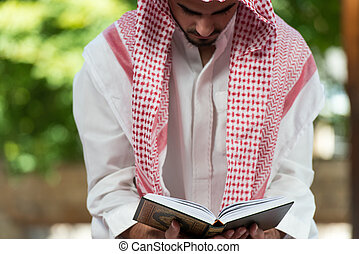 Humble Muslim Prayer - Young Muslim Man Making Traditional...