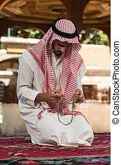 Muslim Praying In Mosque - Young Muslim Man Making...