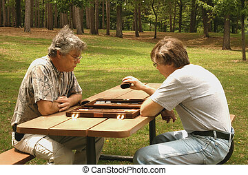 men playing backgammon - two senior men playing backgammon...