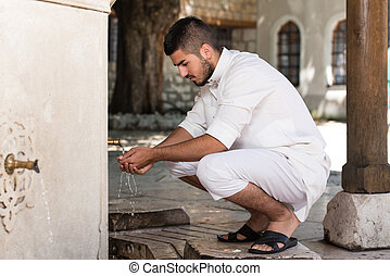 Islamic Religious Rite Ceremony Of Ablution Hand Washing -...