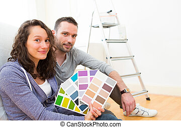Young couple choosing colors of their new flat - View of a...