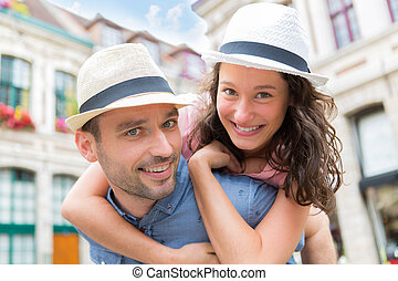 Young happy couple having fun on holidays