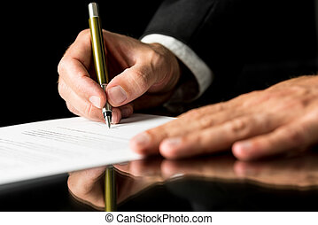 Document signing - Closeup of male hand signing legal or...