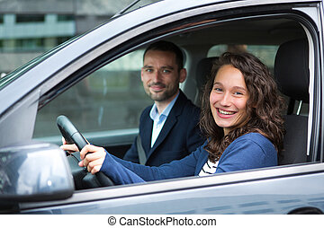 Young business man couple in their brand new car - View of a...