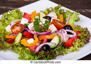 Fresh vegetable colorful greek salad in white pate