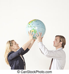 The whole world in our hands - male and female professional...