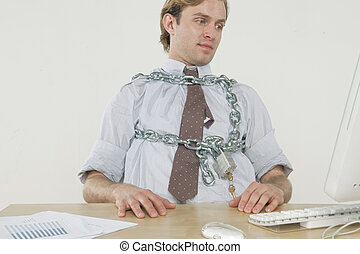 Chained to the desk - concept: professional man \'chained\'...