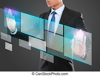 Businessman pressing virtual media button