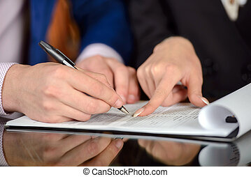 Business People - Businessman and woman hand signing...