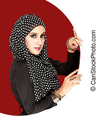 Fashion portrait of young beautiful muslim woman with black scar