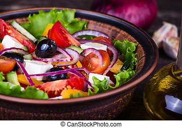 Fresh vegetable colorful greek salad in pate, close up