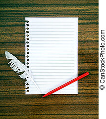 Notepaper and white feather, pen Surrender, beaten, admit...