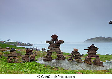 Stone figures - An inukshuk, a traditional stone sculptures...