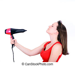 Woman with long hair holding strong blow dryer isolated on...