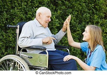 Hi Five  - Playful doctor with patient at the nursing home.