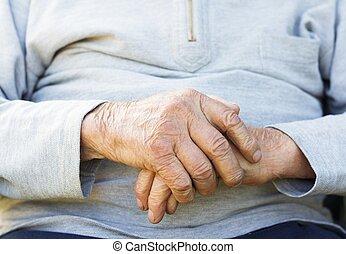 Wrinkled Hands - Lonely senior man praying for better life