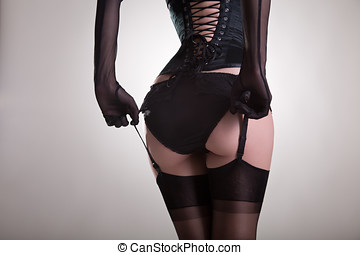 Sexy female buttocks in vintage lingerie, studio shot on...