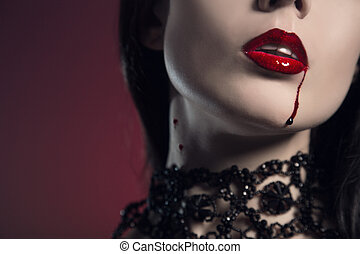 Sensual young woman with red lips bitten by vampire, studio...