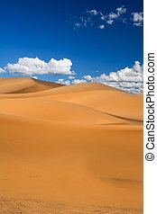 sand dunes and cumulus clouds over them, Erg Chebbi, Morocco...