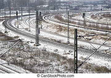 winter railways - many railroad tracks covered by fresh snow...