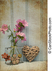 Beautiful flower in vase with heart still life love concept...