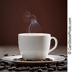 steaming coffee cup - cup of steaming coffee on brown wooden...