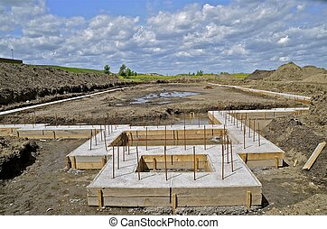 Foundation of an apartment complex - The foundation of a...