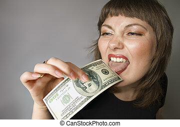 Bizarre woman. Taste of the money. - Woman with hand of $100...