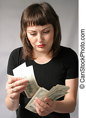My Money - Sullen young woman counts money in her hands