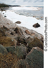 Winter lake rocky shore - Scenic view of winter lake...
