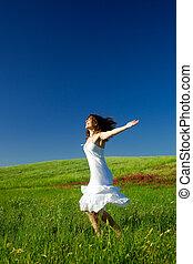 Dancing woman - Beautiful happy young woman dancing on the...