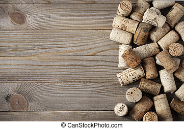 Assorted wine corks - Heap of assorted wine corks on wooden...