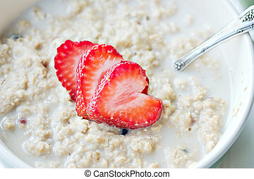Oatmeal - Macro of a bowl of hot oatmeal with fresh...