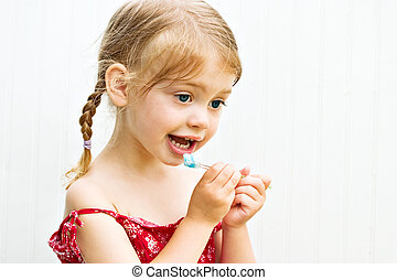 Child Cute little girl brushing her teeth - Cute little girl...