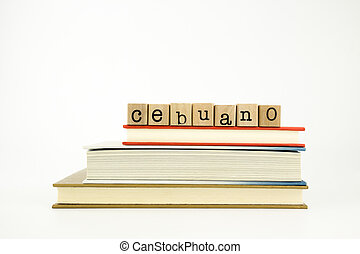 cebuano language word on wood stamps and books - cebuano...