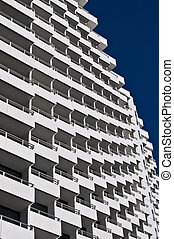 Balconies - rows of many white balconies of a modern...
