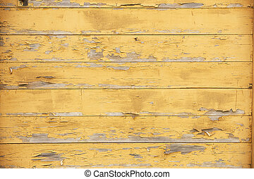 old planks with peeling yellow paint