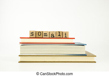 somali language word on wood stamps and books - somali word...