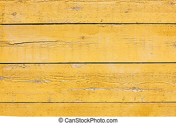 old planks with bright yellow paint
