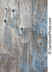 grey wooden board with knots and blue paint - grey wooden...