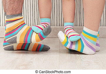 family in socks - feet of a beautiful family with striped...