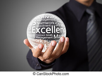 Excellence word in crystal ball - Businessman hand showing...