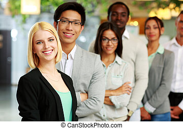 Portrait of a smiling businesswoman standing in front of...